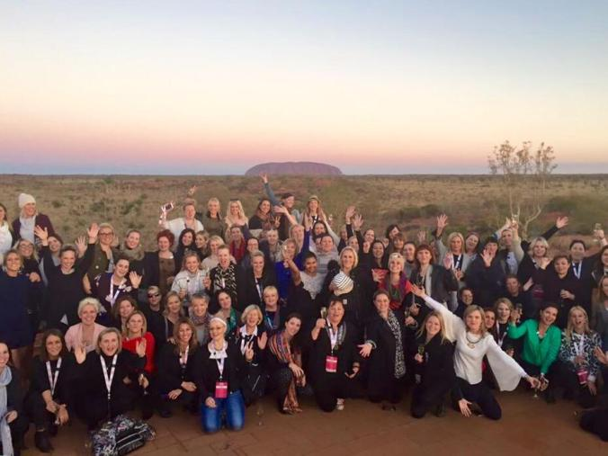 The Movers and Breakers in front of Uluru